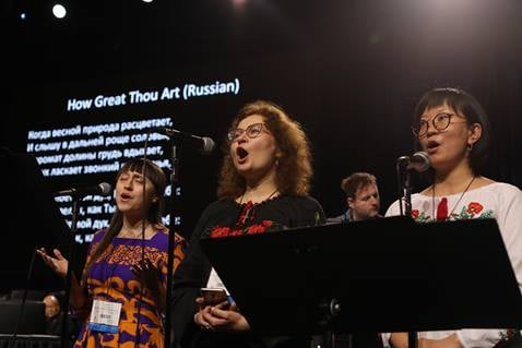 (From left) Julia Stukalova and Yulia Starodubets (Eastern Russia-Central Asia Provisional), and Marina Yugay (Northwest Russia Provisional) sing during the Feb. 23 morning of prayer at the 2019 Special Session of the United Methodist General Conference in St. Louis. Photo by Kathleen Barry, UM News