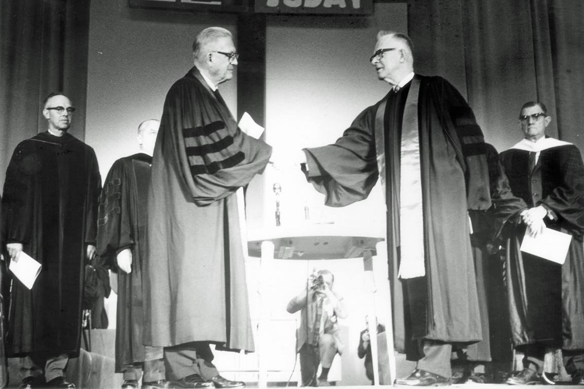 Bishops from The Methodist Church and Evangelical United Brethren Church join hands as The United Methodist Church is formed. Photo courtesy of United Methodist Commission on Archives and History.