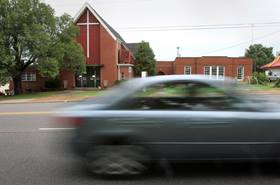 This car passes West Nashville United Methodist Church, but many Christians are making time in their busy schedules to work on their spiritual lives with a small group. File photo by Kathleen Barry, United Methodist Communications.