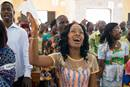 Claudia Teli N'guessan sings during worship at Temple Emmanuel United Methodist Church in Man, Côte d'Ivoire, in this 2015 file photo. Photo by Mike DuBose, UM News.