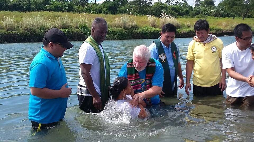 United Methodist pastors from North Georgia join in baptizing 47 people in a river in Angat, Philippines. The North Georgia Conference partners with the Bridges Philippines project. Photo by the Rev. Joey Galinato.