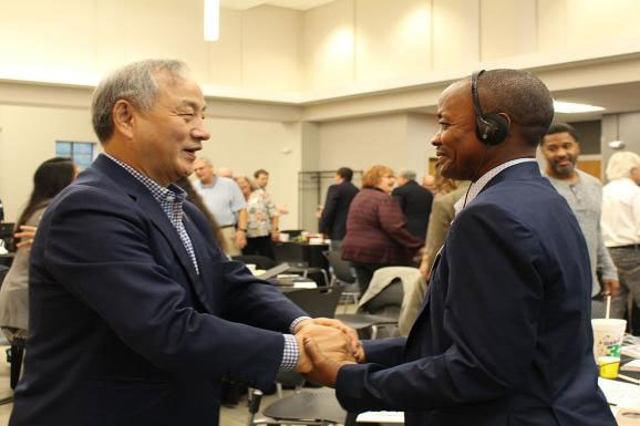 Connectional Table members greet one another at a meeting. File photo courtesy Connectional Table.