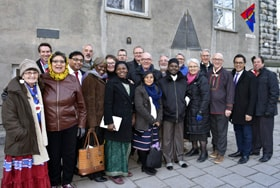 Methodists from Norway and international guests gather outside the Methodist Church in Trondheim, Norway, during the 100-year celebration of the first Sami Congress. The center plaque denotes the church as a United Methodist historic site. Photo by Karl Anders Ellingsen.