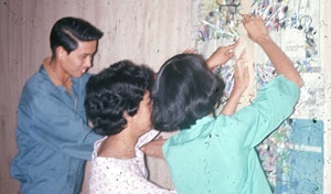Rafael Santos, MarLu Primero, and Fely Mariano prepare for worship at Christmas Institute 1964.