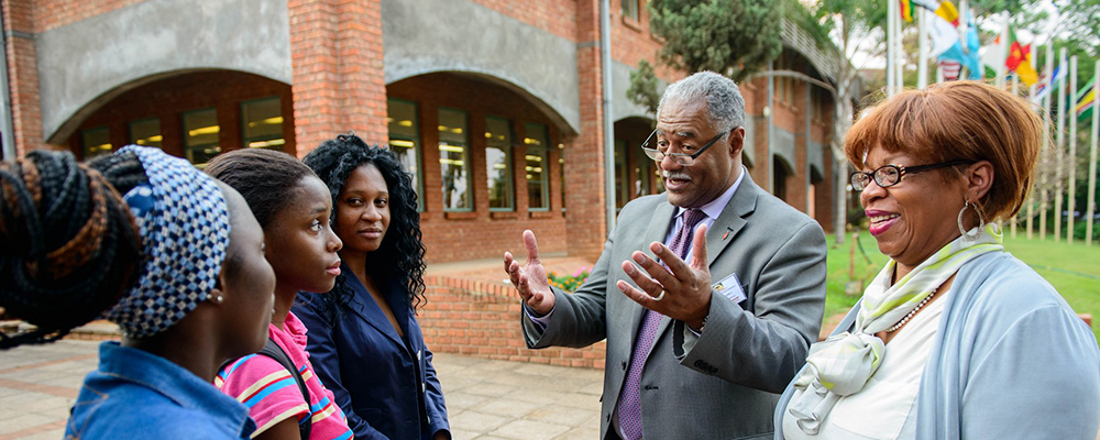 Bishop Julius C. Trimble, chair of the development committee of teh AU Board of Directors stops to talk with AU students.