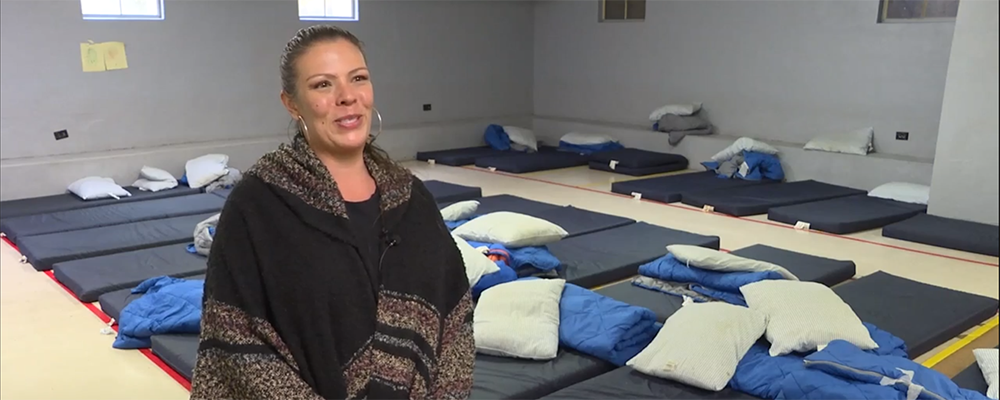Jennifer Covarrubias from Rogue Retreat, stands in front of sleeping mats that 141 homeless people used as a home during the Winter months at the Kelly Shelter located in the basement of First United Methodist Church, Medford, OR.