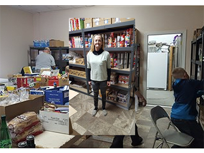 "Edwina ""Wendy"" Kent poses in front of shelves housing food distributed by the Rupert Food Pantry. Courtesy photo."