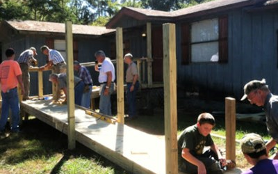 Volunteers from Imagine Ministry help build wheelchair ramp for Agnes Futch. Courtesy photo.