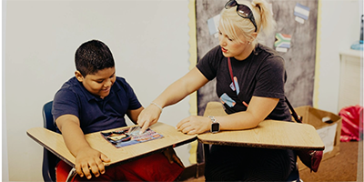 Another volunteer tutoring a youth at the Corner's Academy.