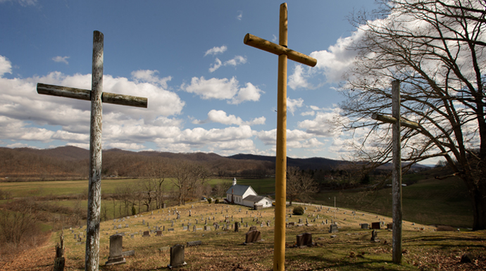 Three crosses stand above the cemetery at Israel United Methodist Church near Montrose, W.Va. Photo by Mike DuBose, UMNS