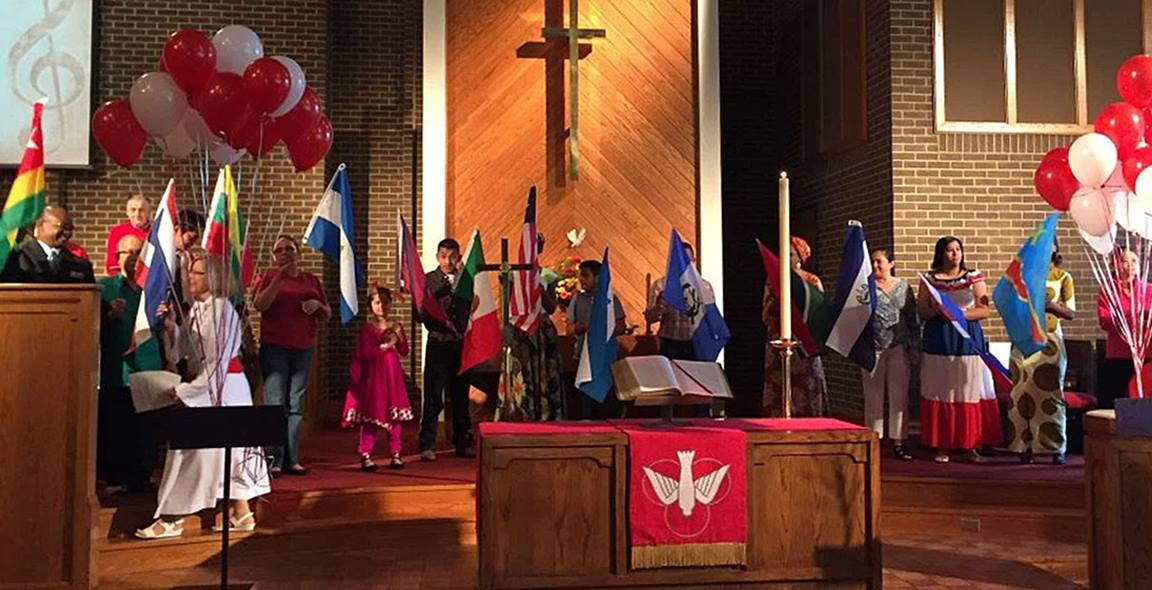 Members of Central United Methodist Church in Charlotte, NC celebrate with a Parade of Members' Nations Flags ceremony. Hispanic laypeople at North Carolina church are leading programs that unify the church membership. Photo courtesy of Central United Methodist Church.
