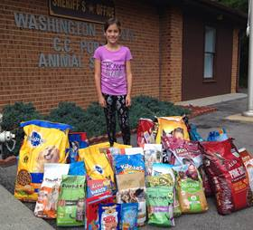 Marley Jane Musser collected about 30 bags of food for the Washington County C.C. Porter Animal Shelter. Photo courtesy of the Musser family.