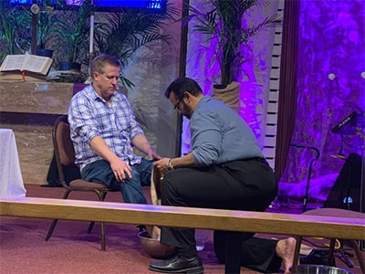Pastor Herman Perez washes Pastor Charlie Moore's feet during Maundy Thursday worship service. Courtesy photo.