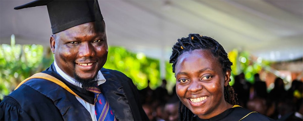 Claudine Migisha (right) receives congratulations from Wehnam Dabale, upon her graduation from Africa University in Mutare, Zimbabwe. Migisha, from Goma, Congo, was part of the United Methodist-related school's 25th graduating class. Dabale is the university's international student advisor. Photo courtesy of Africa University