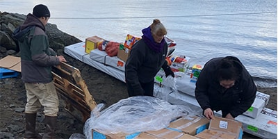 Food and supplies unloaded on the shore for distribution to Chignik villages on the Aleutian Islands, Alaska. Photo: Courtesy Chignik Intertribal Council.