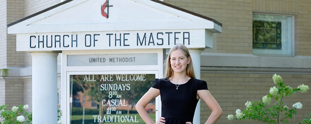 Kaleigh Rudge poses in front of home congregation's marquee. Courtesy photo.