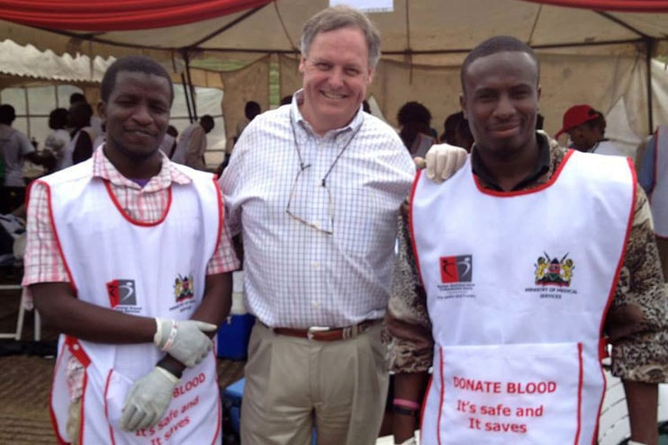 Scott Gilpin (center) stands with Red Cross workers with whom he volunteered in the days following the Westgate Mall massacre in Kenya. Photo courtesy of Scott Gilpin.