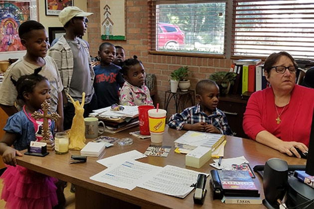 Rev. Karen Jones (far right) helping African refugees at First United Methodist Church in Center, Texas. Photo courtesy of Shannon Martin, Texas Annual Conference.