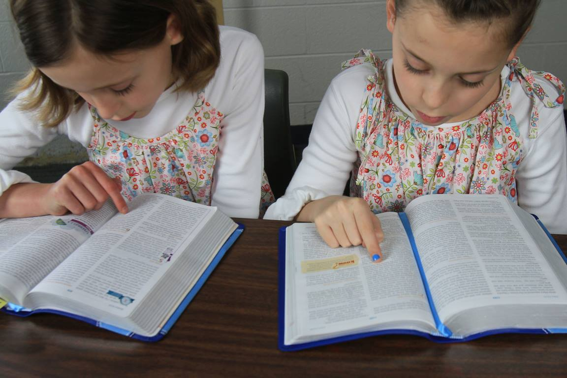 Studying the Bible is important at every age. Photo illustration by Kathleen Barry, United Methodist Communications.