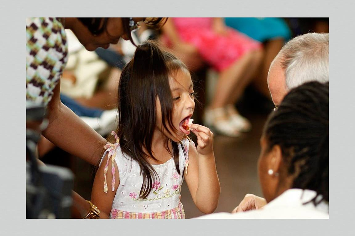 A child takes communion at First Grace United Methodist Church in New Orleans, Louisiana. Photo by Kathy L. Gilbert, UM News.