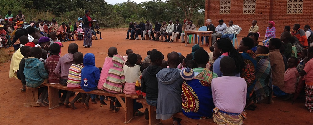 A community awareness meeting in Malawi offers information on what HIV services are available and how to access them. Photo: WorldHope Corps.