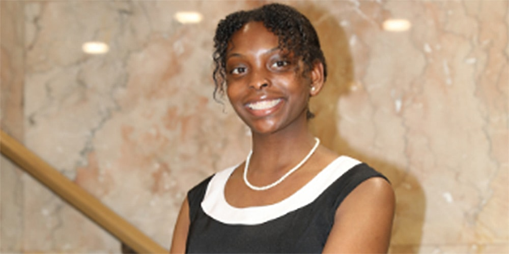 ViaFaith McCullough poses on steps at General Board of Higher Education and Ministry for photo. Courtesy photo.