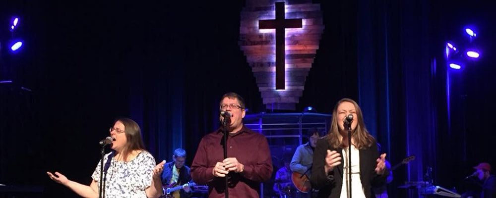 Delaney Tacka (far right) singing at concert. Courtesy photo.