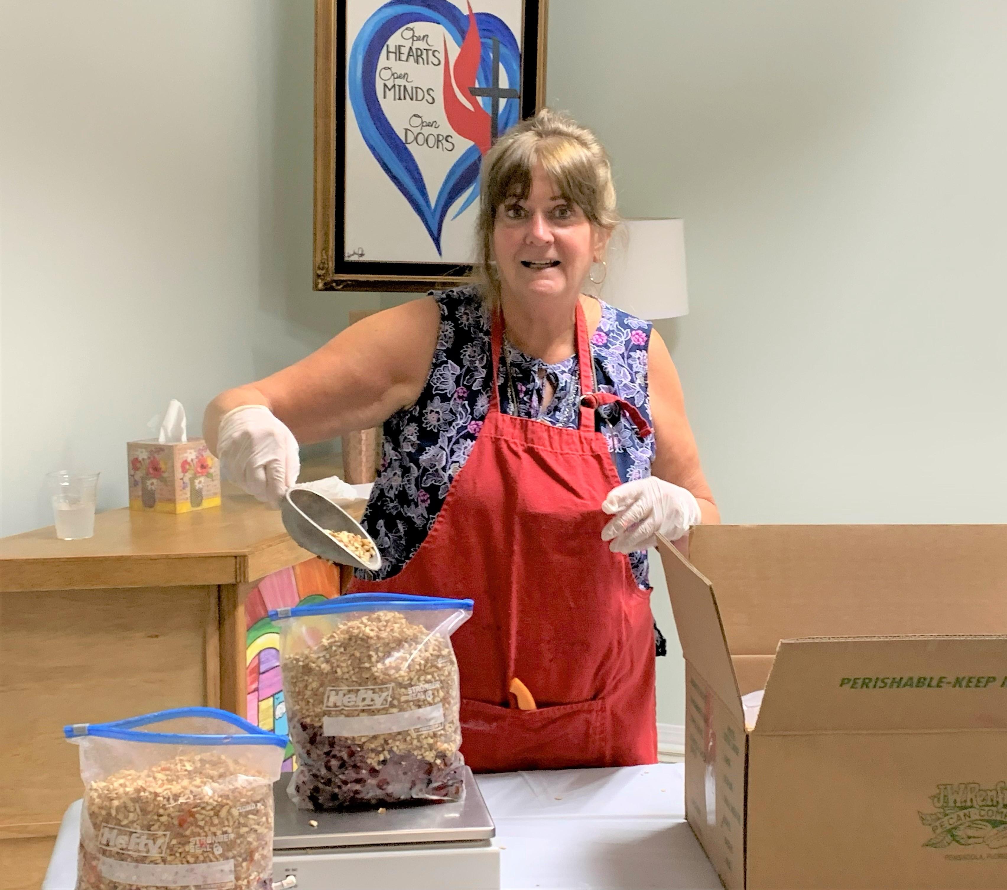 Volunteers at Robertsdale United Methodist Church spends days making fruitcakes.