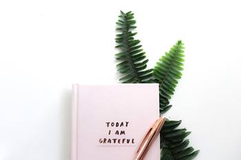 Gratitude journal Photo by Freshh Connection on Unsplash