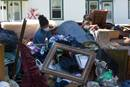 Jeremain (left) and Jeremaih Robinson pile up ruined furnishings from a home that was heavily damaged by flooding in Baton Rouge, La. The 16-year-old twins were part of a volunteer team from First United Methodist Church in Baton Rouge. Photo by Mike DuBose, UM News.