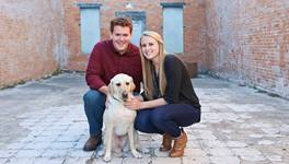 Hillary Oswald leans on her faith has her rare genetic disorder takes away her vision. Pictured (l-r): Scott Oswald, Hillary's husband; Hillary Oswald; guide dog Alika.