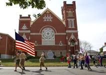 Boy Scouts from Troop 222 march in front of Leipsic (Ohio) United Methodist Church during the parade that kicks off the town's annual Fall Festival.
