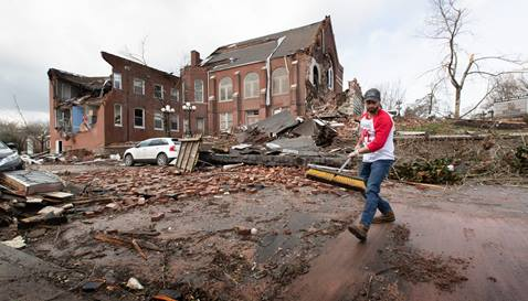 Volunteer Sumant Joshi clears tornado debris in front of East End United Methodist Church in Nashville, Tenn. Photo by Mike DuBose, UM News.