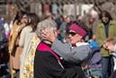 Church member Rita Wigger (right) embraces the Rev. Judi Hoffman during an outdoor worship service in the park adjacent to East End United Methodist Church in Nashville, Tenn. The church building was heavily damaged by a March 3 tornado. Photo by Mike DuBose, UM News.