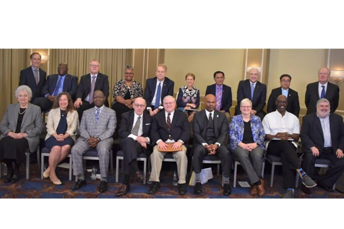 Members of the negotiating team of United Methodist bishops and UMC other leaders pose for a photo in Tampa, Fla., in January after discussing details of the Protocol of Reconciliation & Grace Through Separation. The protocol was achieved with help of mediator Kenneth Feinberg and his team.