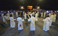 Clergy members bless the elements of Holy Communion during the 2016 United Methodist General Conference in Portland, Ore. The Commission on the General Conference met March 21 to discuss next steps after coronavirus concerns forced the postponement of this year's legislative assembly. File photo by Paul Jeffrey, UM News.