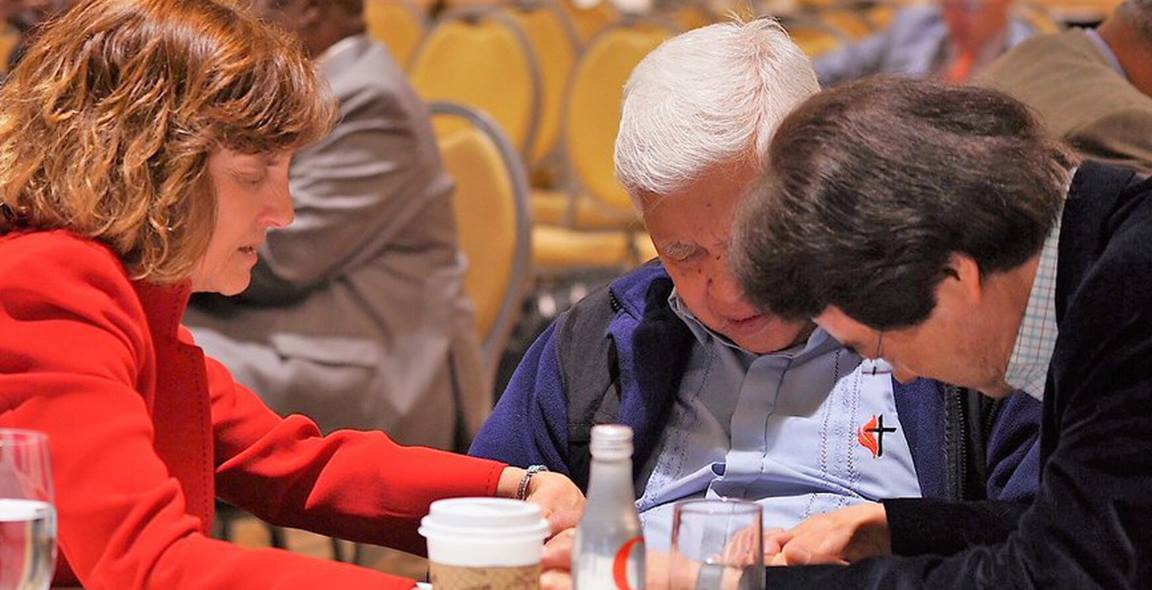Pausing to listen in prayer allows time for God to speak to our hearts. Photo courtesy Council of Bishops.
