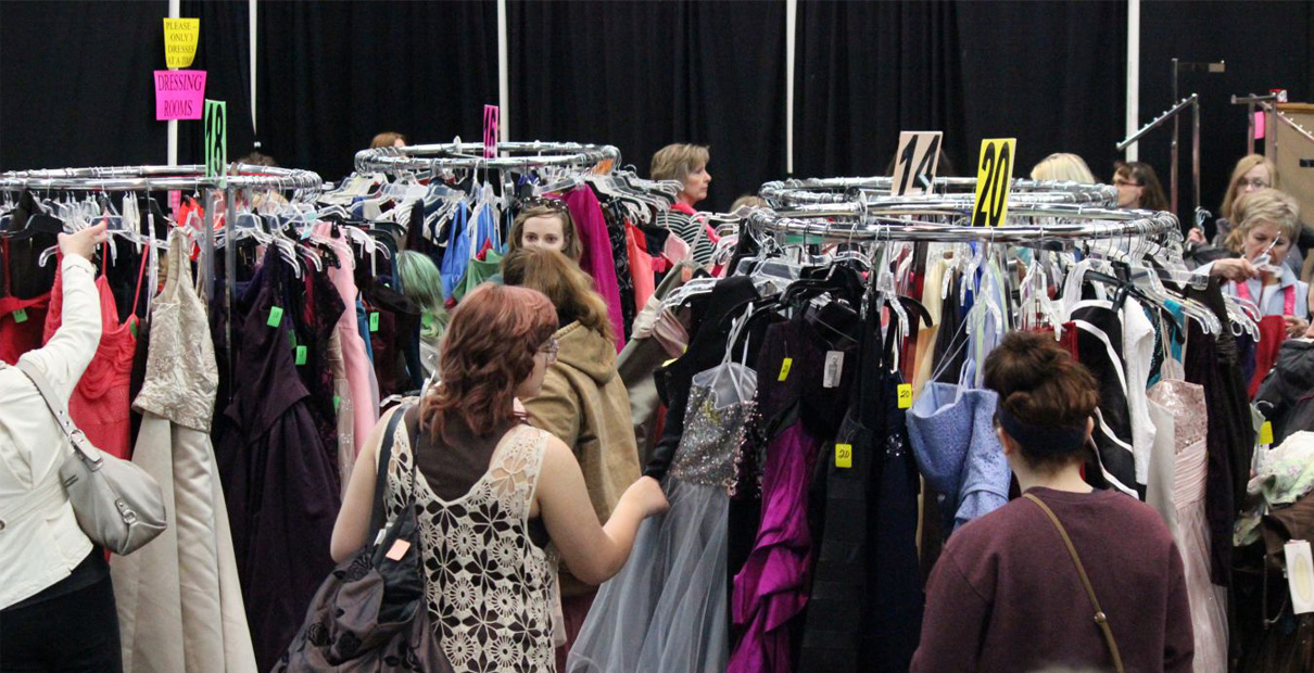 High school students and parents shop for prom dresses at Prom Boutique at Woods Chapel United Methodist Church. Photo courtesy of Prom Boutique.