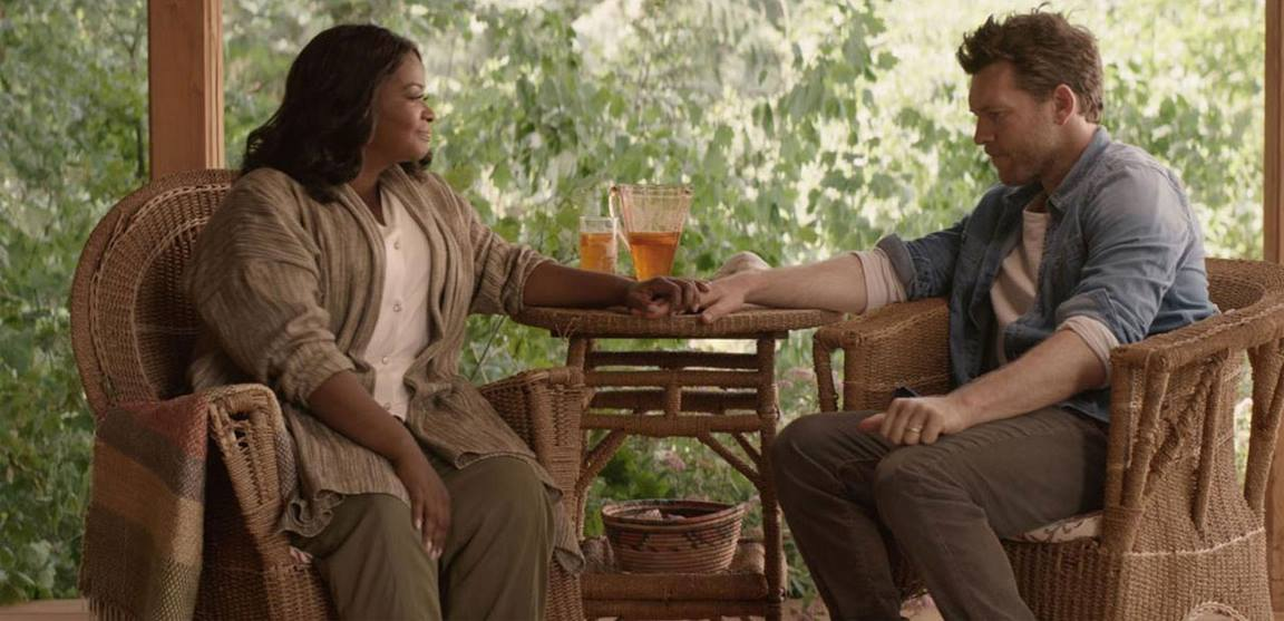 """God (left) comforts grief-stricken Mack as he tries to recover from a family tragedy in this scene from """"The Shack."""" Photo courtesy of Summit Entertainment."""