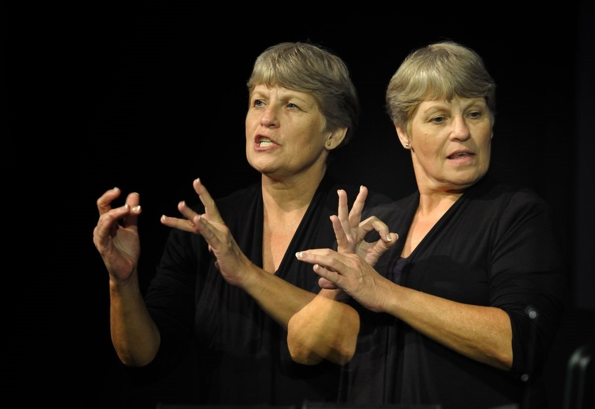 Betty Ostrom provides American Sign Language interpretation at the 2012 United Methodist General Conference in Tampa, Florida. Ostrom is a member of Pine Castle United Methodist Church in Orlando. A double exposure for UMNS by Paul Jeffrey.