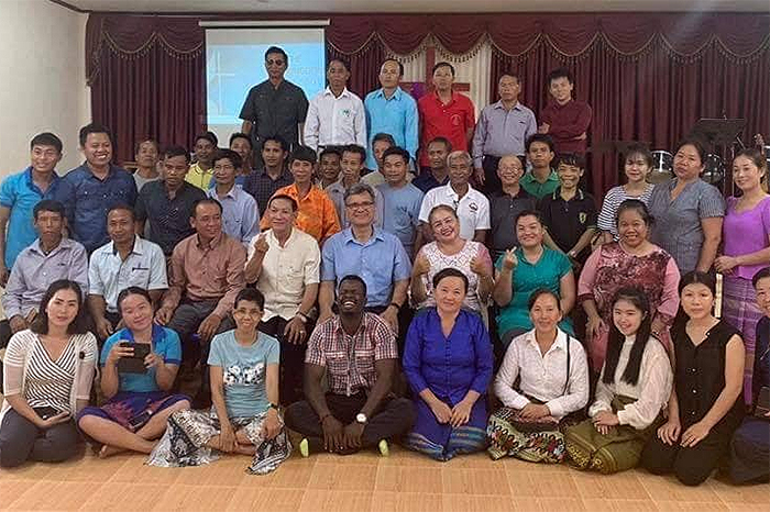 Pastors and other leaders take time for a group photo during a mission summit held in August 2019. General Secretary Thomas Kemper joined the group for the event; he is pictured in the center.