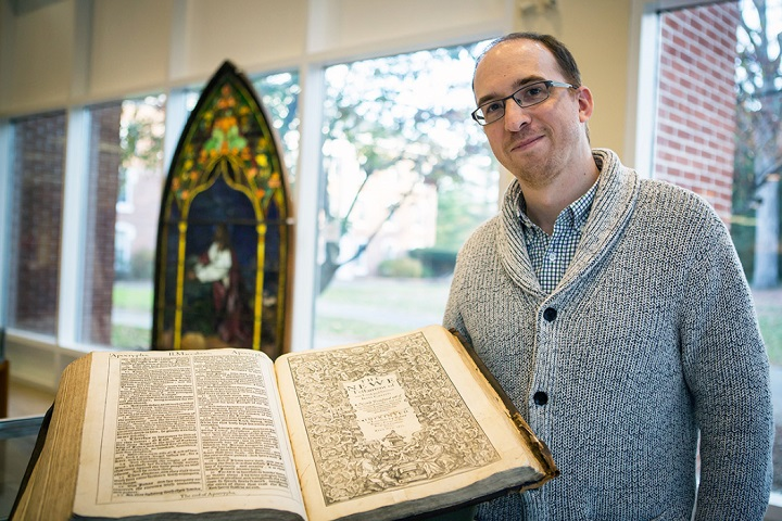"Archivist Brian Shelter shows a rare first edition King James ""He"" Bible in the Drew collection."