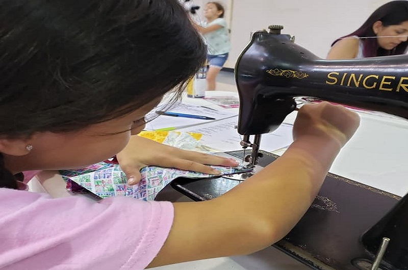 Katie Chapa, 8, is part of the sewing group at La Trinidad United Methodist Church sewing group. Photo by Valerie Mendoza.
