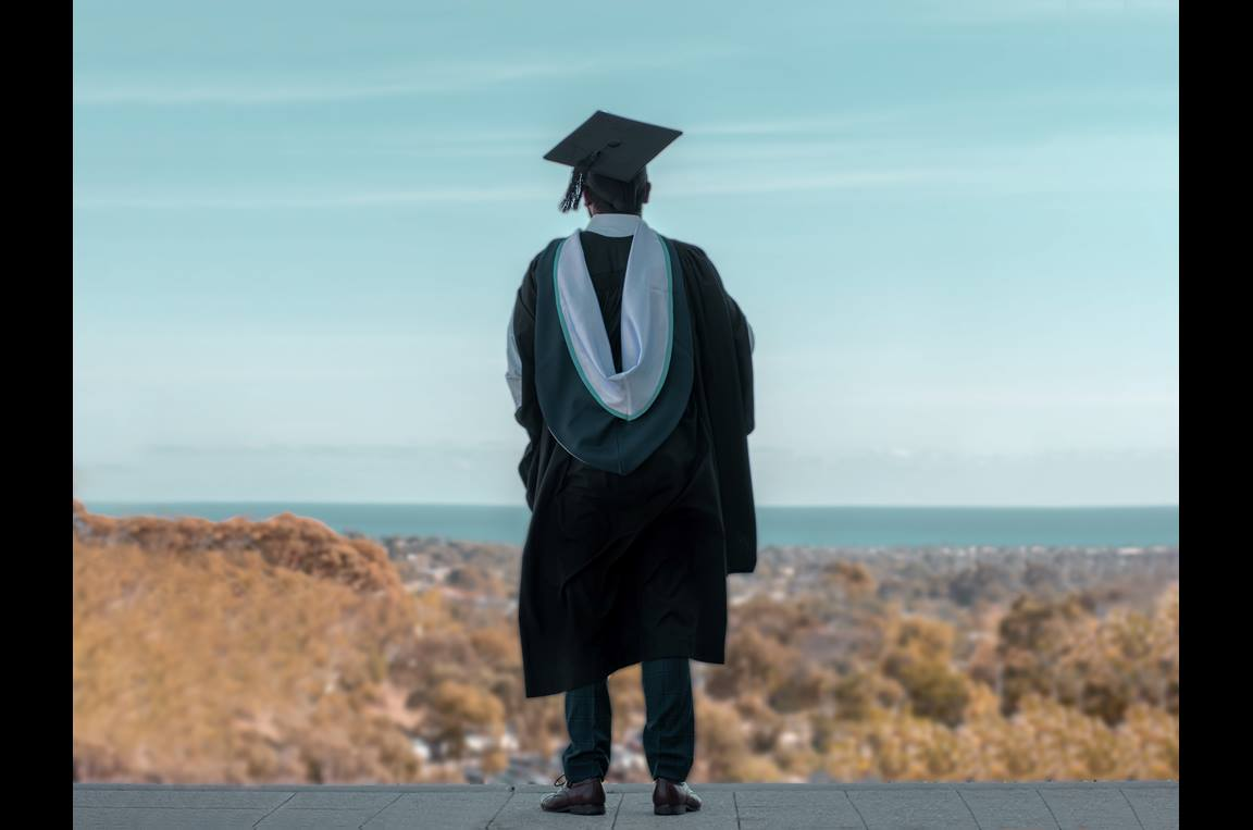 One United Methodist teen, nearing high school graduation, ponders lessons learned during the pandemic-era ending of his senior year. Photo by Terrence  Thomas (@tezthomz) at Unsplash