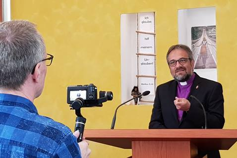 A camera is set to record the 2020 Good Friday online service with Germany Bishop Harald Rückert. As elsewhere, United Methodist churches in Germany were closed because of the coronavirus pandemic. The service was recorded on Holy Thursday at the United Methodist Church of Christ Frankfurt am Main, Germany. Photo by Leonie Minor.
