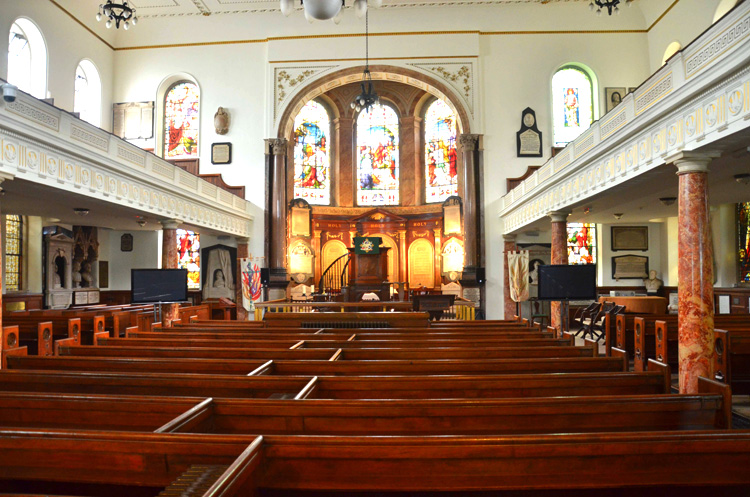A view down the nave or principal longitudinal area of a church in Wesley's Chapel in the London Borough of Islington. Originally City Road Chapel, the Methodist church was built in 1778 under the direction of John Wesley. Photo by Bob Johnson, courtesy of Wikimedia Commons.