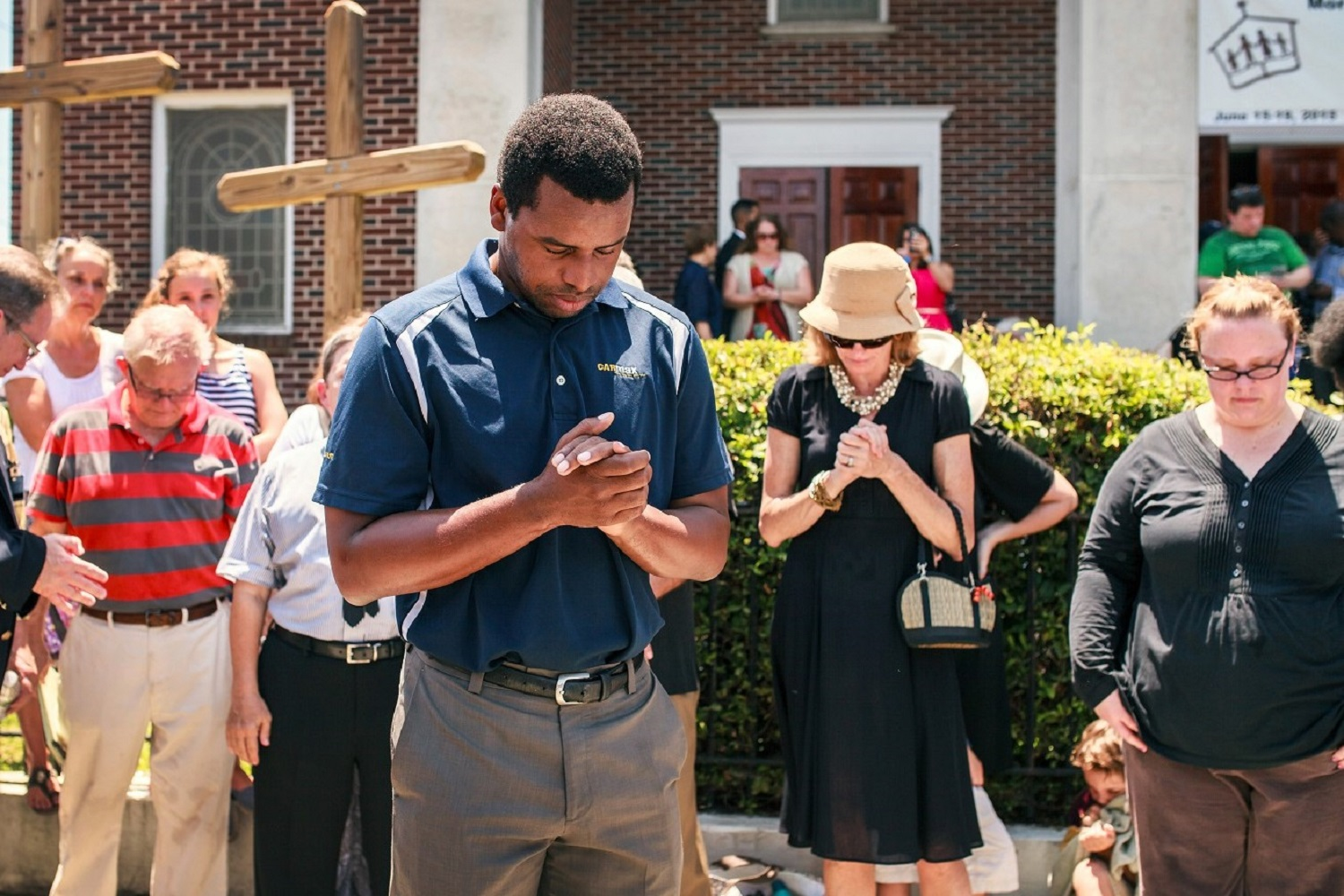 Robert Griggs (center)  prays with others outside Morris Brown African Methodist Episcopal Church in Charleston, S.C.  United Methodists joined AME members in prayers following the deadly shooting at Emanuel AME Church in Charleston. Photo by Lekisa Coleman-Smalls, UMNS