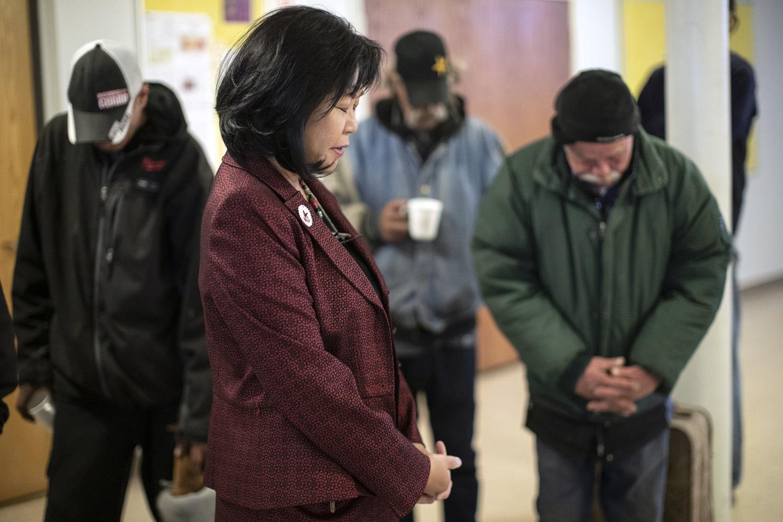 Members pray at First United Methodist Church of Salt Lake City, Utah.