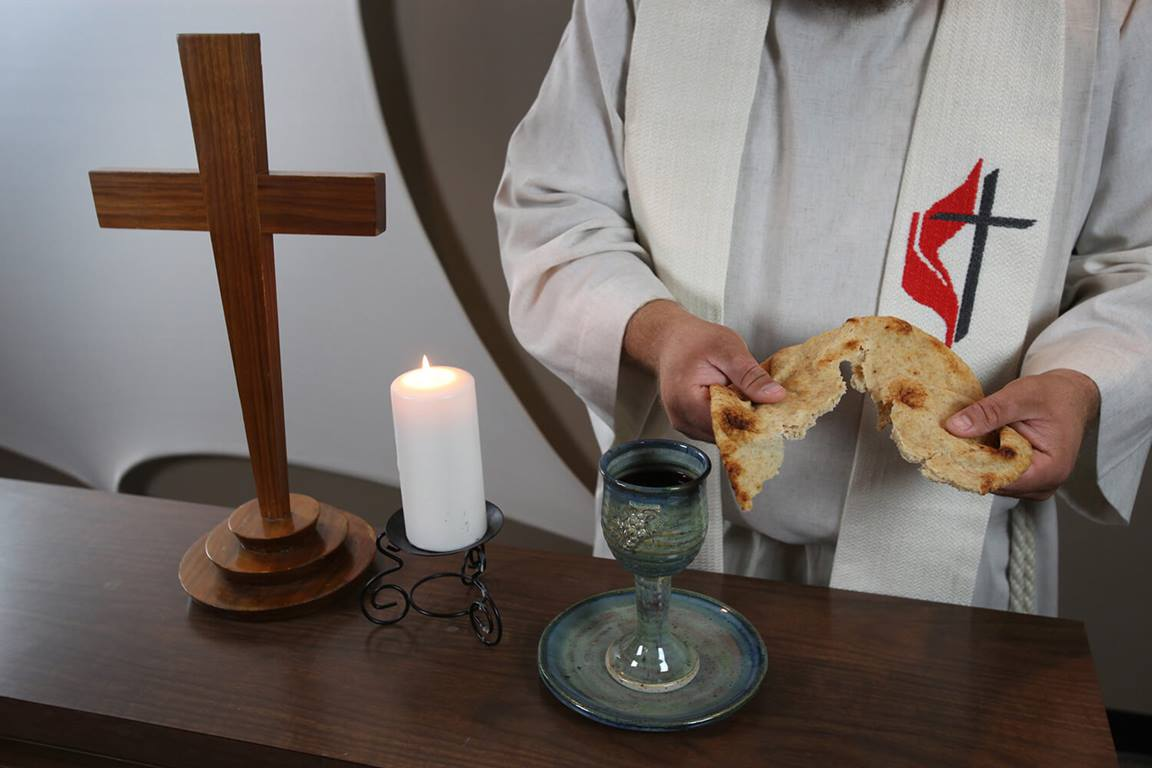 As we give the bread we have broken at the Great Thanksgiving as Jesus did at the Last Supper, we also say the words Jesus said. Photo illustration by Kathleen Barry, United Methodist Communications.