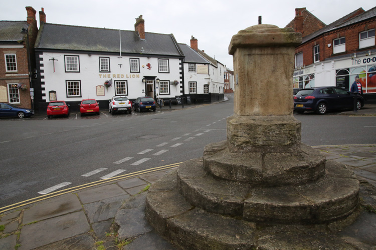 John Wesley preached from these steps at The Market Cross in the heart of Epworth. Photo by Kathleen Barry, United Methodist Communications.